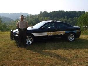 Officer Standing by Patrol Car